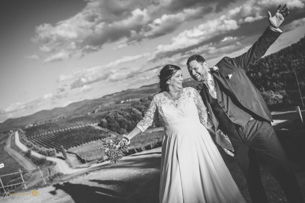 Bride and groom have fun in the vineyard