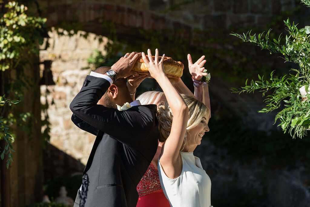 Groom and Bride break bread during the ceremony