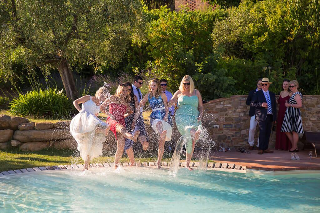 Bride and her friend have fun in the pool