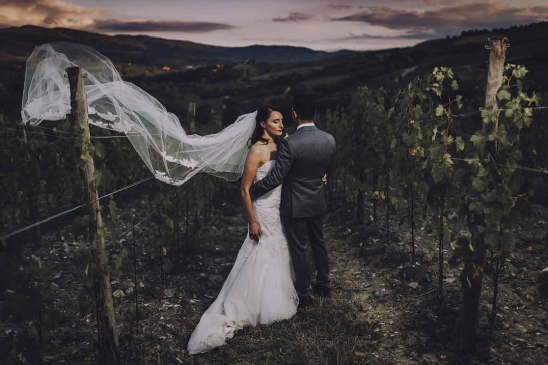 Jane & Aimun walk through the vineyard