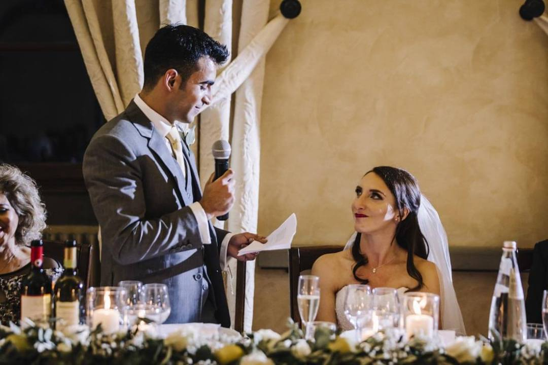 The groom reads a speech for the bride and the guests