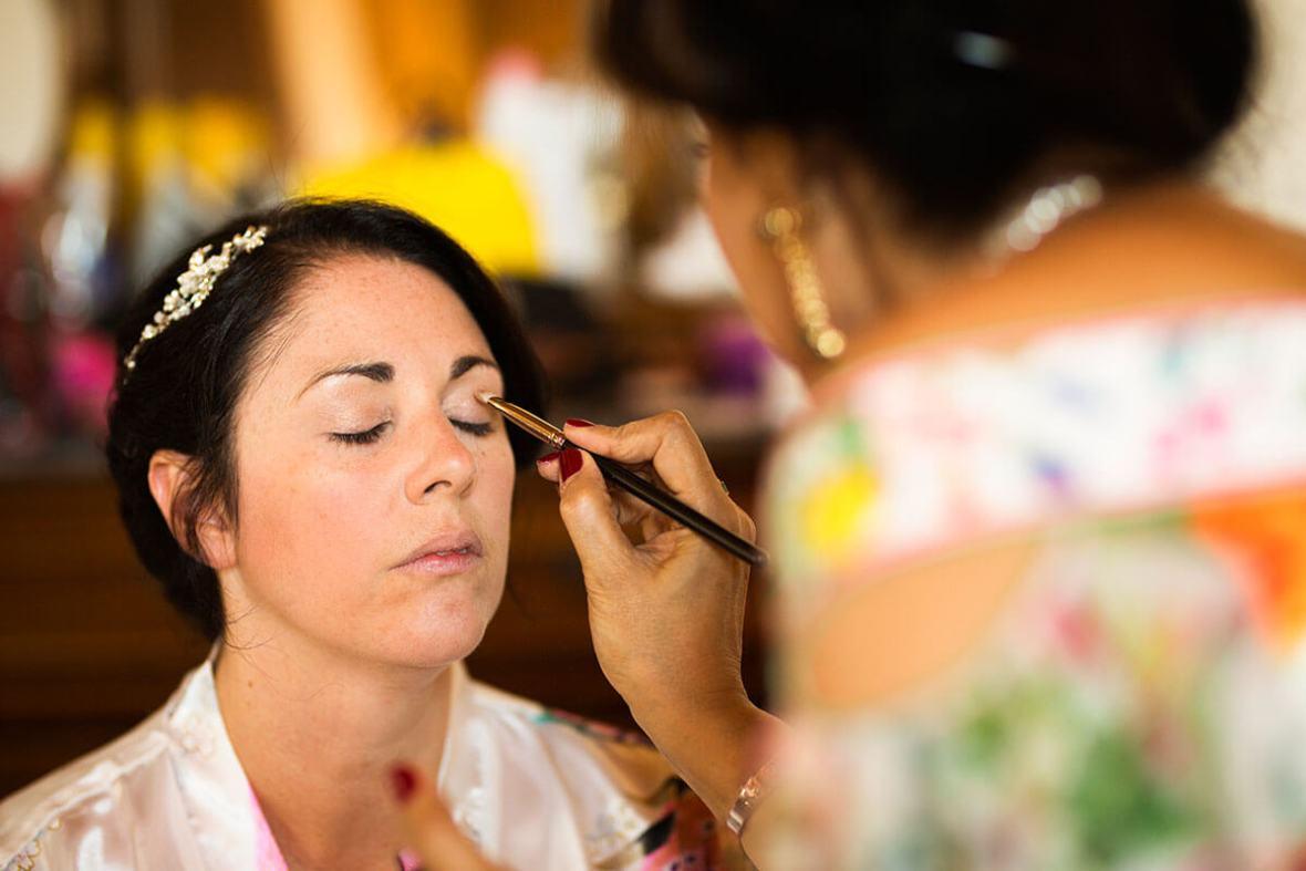 A make-up artist make up the bride