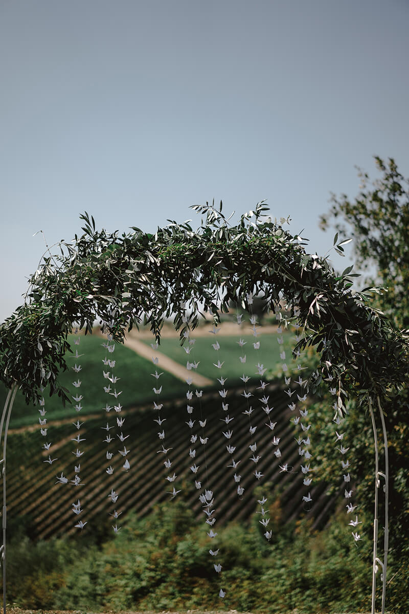 ceremony overlooking tuscan vineyards