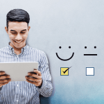 man with laptop and smiley face logos