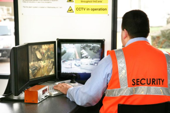 security surveillance footage monitored by security guard