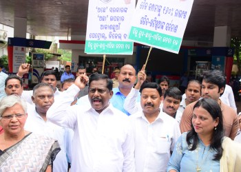 Leaders and workers of Biju Janata Dal demonstrate in front of a petrol pump in Bhubaneswar, Friday OP photo