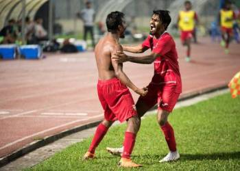 Ali Fasir (shirtless) of Maldives celebrates with a teammate after scoring the winner against India in the SAFF Cup final in Dhaka