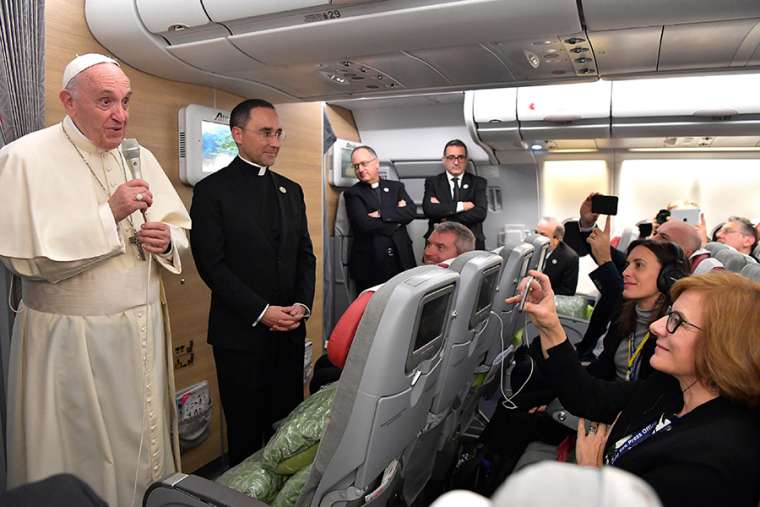 Pope tamps down Maduro's hopes for Vatican intervention, marries couple in plane