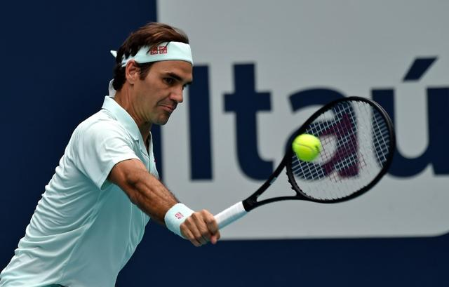 Federer, who won his fourth Miami title, broke Isner three times in a blazing opening set. (Image: Reuters)
