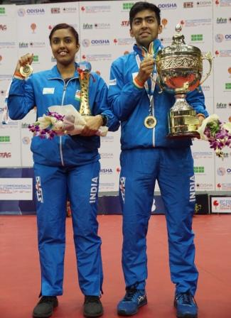Ayhika Mukherjee and Harmeet Desai pose with the trophies in Cuttack Monday. OP Photo