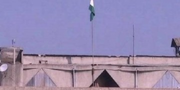 The Indian Tricolour atop the Civil Secretariat building in Srinagar. The empty pole is the one where the J&K flag used to fly