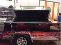 Wetsounds Stealth 6 soundbar installed on Uncle Bucks BBQ's mobile smoker.