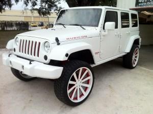 Custom painted matte whit Jeep wrangler four door on Custom painted Forgiatos.