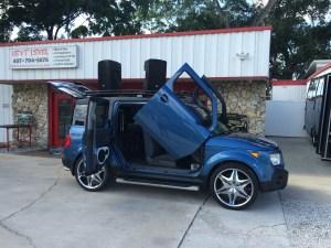 Honda Element Mobile Dj vehicle setup infront of the shop ready for a concert.