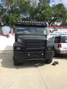 Matte black dip, Custom bumper and light bar on armored truck limo