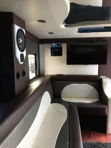 Brown and white Ostrich interior with Mclaren audio, Fiber optic mirrored roof, multicolor LED's, strobes, and two Samsung LED Smart TV's