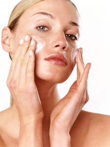 woman applying Immortelle Helichrysum Organic Radiance skincare
