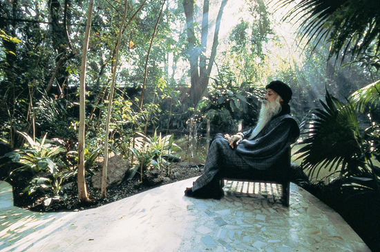 Osho sitting near the pond