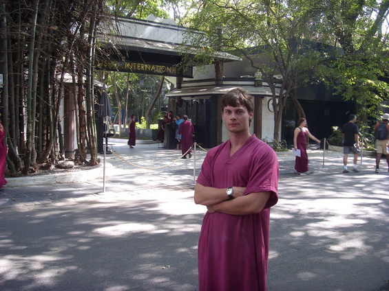 Young man in front of resort