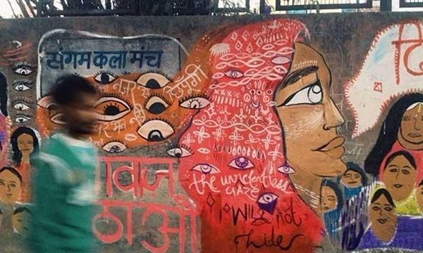 graffiti: woman with many eyes