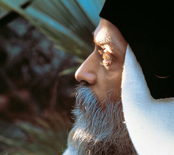 Osho in garden looking up