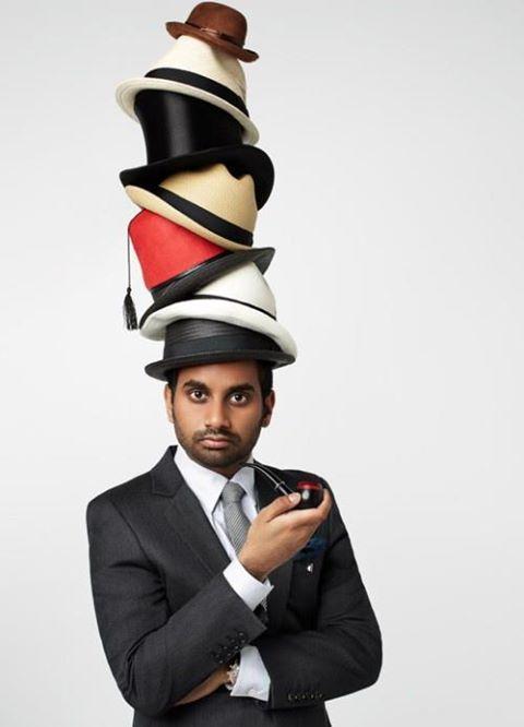 man wearing many hats