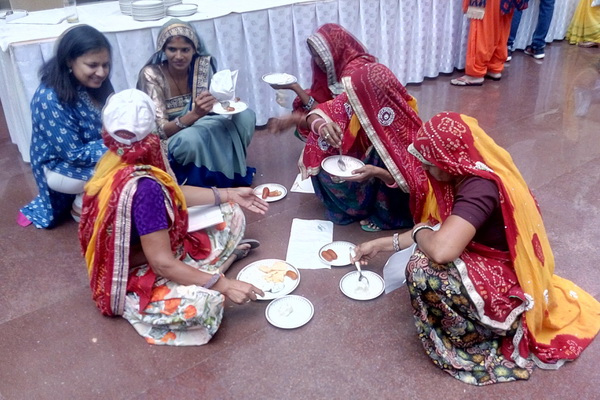 Widows from Rajasthan are more comfortable squatting for lunch