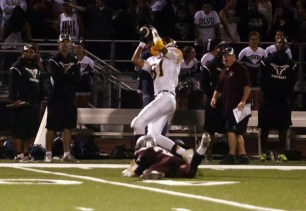 Tyler Bassinger makes a key first down reception in front of the RBV bench