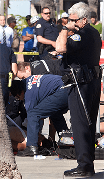 Firefighters perform CPR on a man shot by an Oceanside Police Officer at the Oceanside Harbor