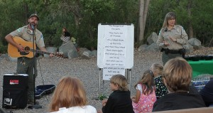 Park rangers Levi Dean and Heidi Gutknecht lead a sing-along at the Kumeyaay Lake Campground Amphitheater as part of the program on Friday night.  (courtesy photo)