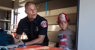 Oceanside Firefighter Gavin Pepsny gives a tour to Gavin Rivera, 4 of Vista, the inside of an ambulance