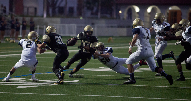 The Warriors Bishop Hernandez cuts to the inside against the Scots defense