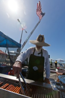 Ken Derr with the Ameican Legion works the grill near the beer garden on Saturday