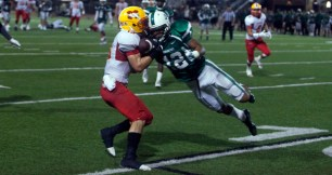Oceanside DB Malavai Taylor puts a viscious hit on Connor Hill, knocking the ball loose for an incompletion