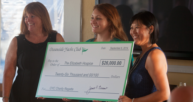 OYC Commodore Janet Bessent presents a donation toAlexandra Prsha and Vatei Campbell with The Elizabeth Hospice