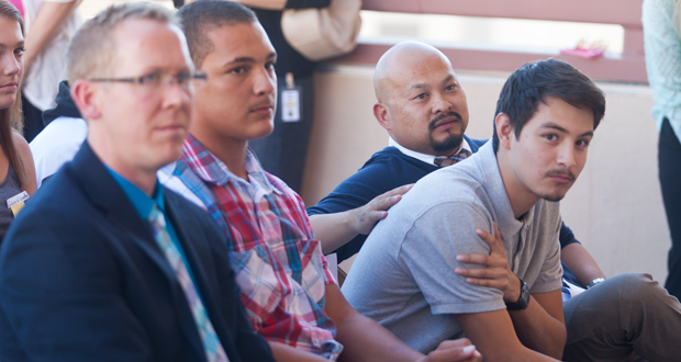Greg Angela, Executive Director of Interfaith Community Services, Amadeo West, Felix Sierra and Vu Nguyen, a mentor with TYA