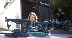 Karen Taylor, a Docent at Heritage Park with some of the sewing machines available at the sale