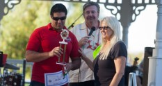 Oceanside Firefighter Bryan Hunt receives the trophy for the firefighters first place chili from Steve Turk and Joan Burns