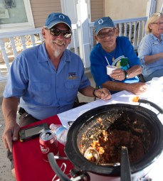 """Beecher Young and Chris Cow at the MainStreet Oceanside chili booth. Beecher said his chili has """"no heat, fresh veggies, chorizo, meat and you keep putting stuff in it until the pot is full."""