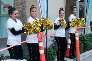 El Camino Dance team cheering on the runners