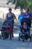 Tami Miller with her son Nick and Jennifer Sylvester pushing Luke.
