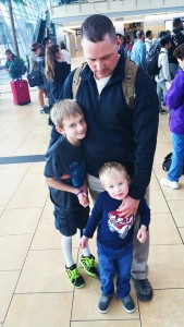 Cameron & little brother greeting Dad who came back from deployment in January (courtesy photo)