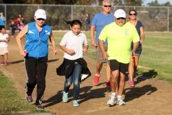 Kathy Kinane and Assemblymember, Rocky Chavez running with a Laurel Elementary student. (click on image to enlarge photo)