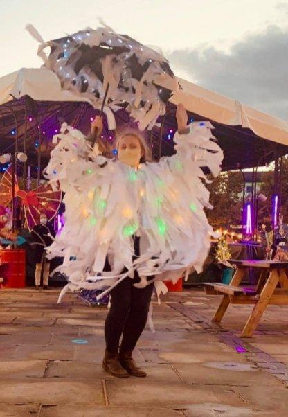 Jess Kemp, Sensory carnival coat, mixed fabrics, bells and lights. Photo Quince Garcia