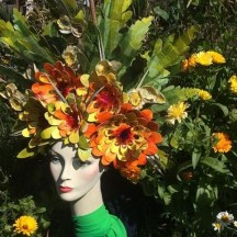 Jess Kemp, In a lockdown Midsummer Garden, carnival head-dress created with recycled materials. NFS