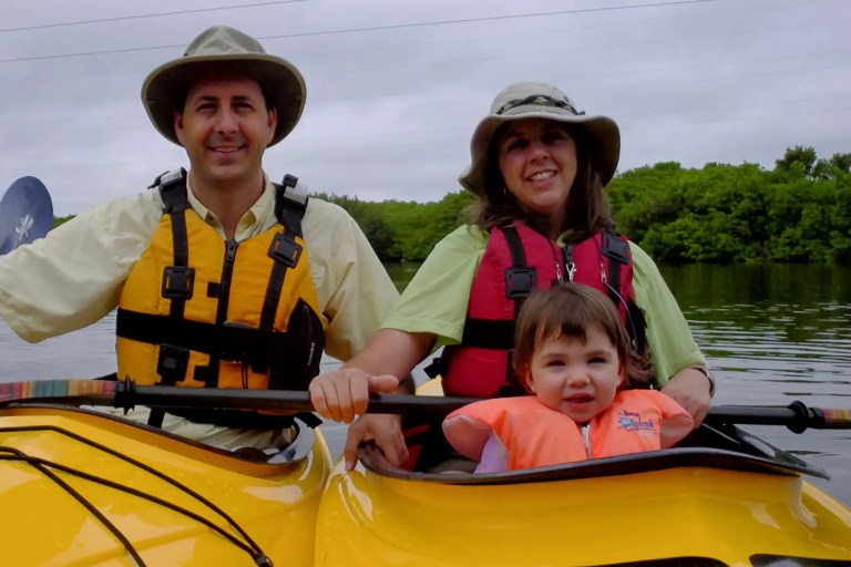What's Osprey Bay Outdoors about? Family.Tom kim and Delaney in eddyline kayaks. when Delaney was very little.