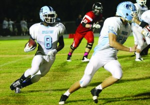 Newsome Wolves junior Chris Bryant runs the ball for a 4 yard touchdown in the second quarter during a recent district game against Bloomingdale.