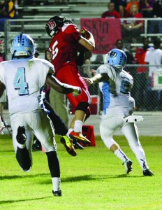 Bulls junior wide receiver Logan Crouse catches a pass from Tommy McLaughlin, scoring a touchdown against Newsome.