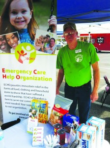 ECHO Volunteer, Gene Edwards, manned the ECHO tent at Revolution's Food Truck Drive on Sunday, Oct. 13.