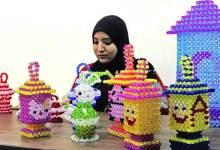 Photo of أربع فتيات مبدعات لفوانيس رمضان بالخرز الملون